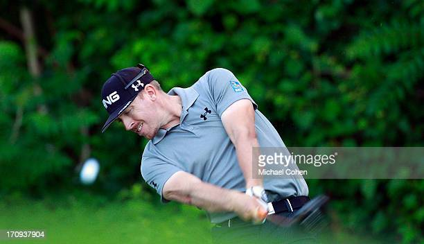 Hunter Mahan hits his drive on the 12th hole during the first round of the Travelers Championship held at TPC River Highlands on June 20 2013 in...