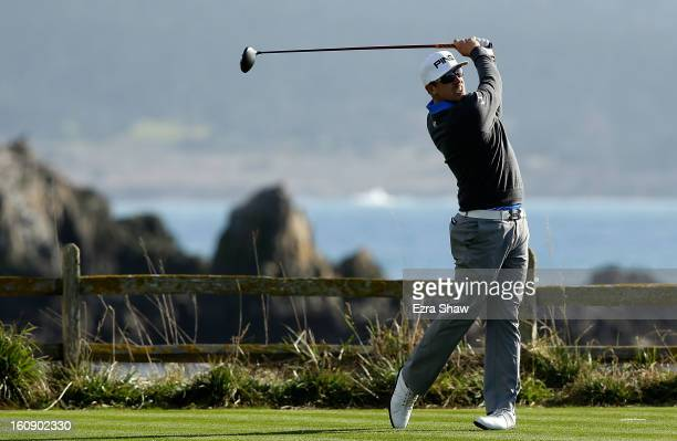 Hunter Mahan hits his tee shot on the 18th hole during the first round of the ATT Pebble Beach National ProAm at Pebble Beach Golf Links on February...
