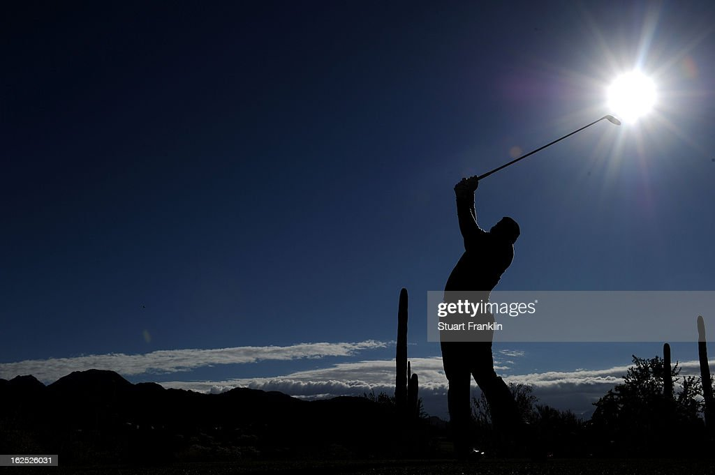 Hunter Mahan hits his tee shot on the ninth hole during the semifinal round of the World Golf Championships - Accenture Match Play at the Golf Club at Dove Mountain on February 24, 2013 in Marana, Arizona.