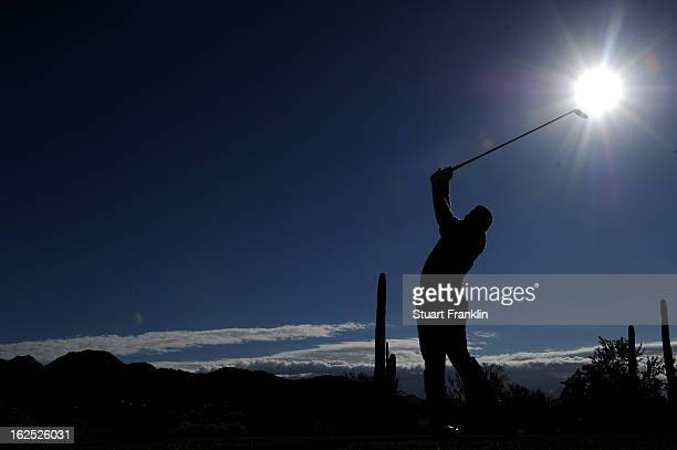 Hunter Mahan hits his tee shot on the ninth hole during the semifinal round of the World Golf Championships Accenture Match Play at the Golf Club at...