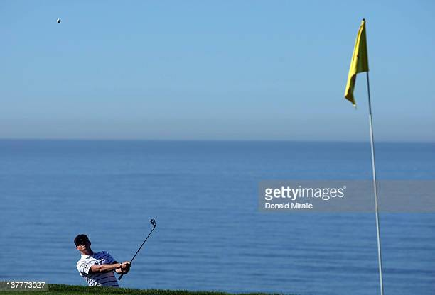 Hunter Mahan hits out of the 4th green bunker during the first round of the Farmers Insurance Open at Torrey Pines Golf Course South Course on...