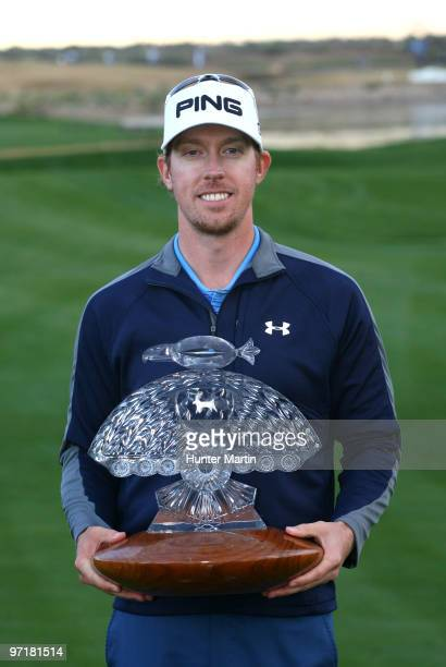 Hunter Mahan holds the championship trophy after winning the Waste Management Phoenix Open at TPC Scottsdale on February 28 2010 in Scottsdale Arizona