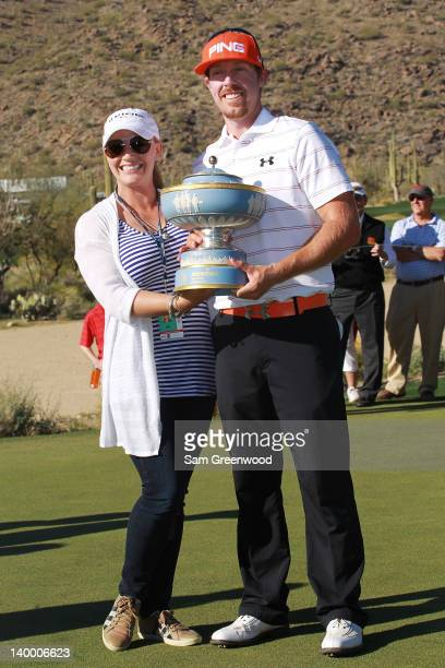 Hunter Mahan holds the Walter Hagen Cup while celebrating with his wife Kandi after winning the championship match during the final round of the...