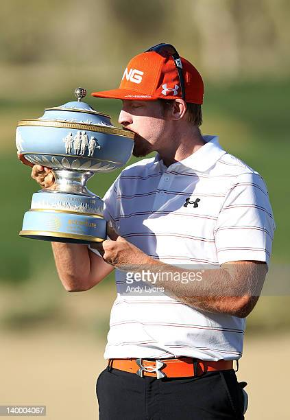 Hunter Mahan kisses the Walter Hagen Cup after winning the championship match during the final round of the World Golf ChampionshipsAccenture Match...