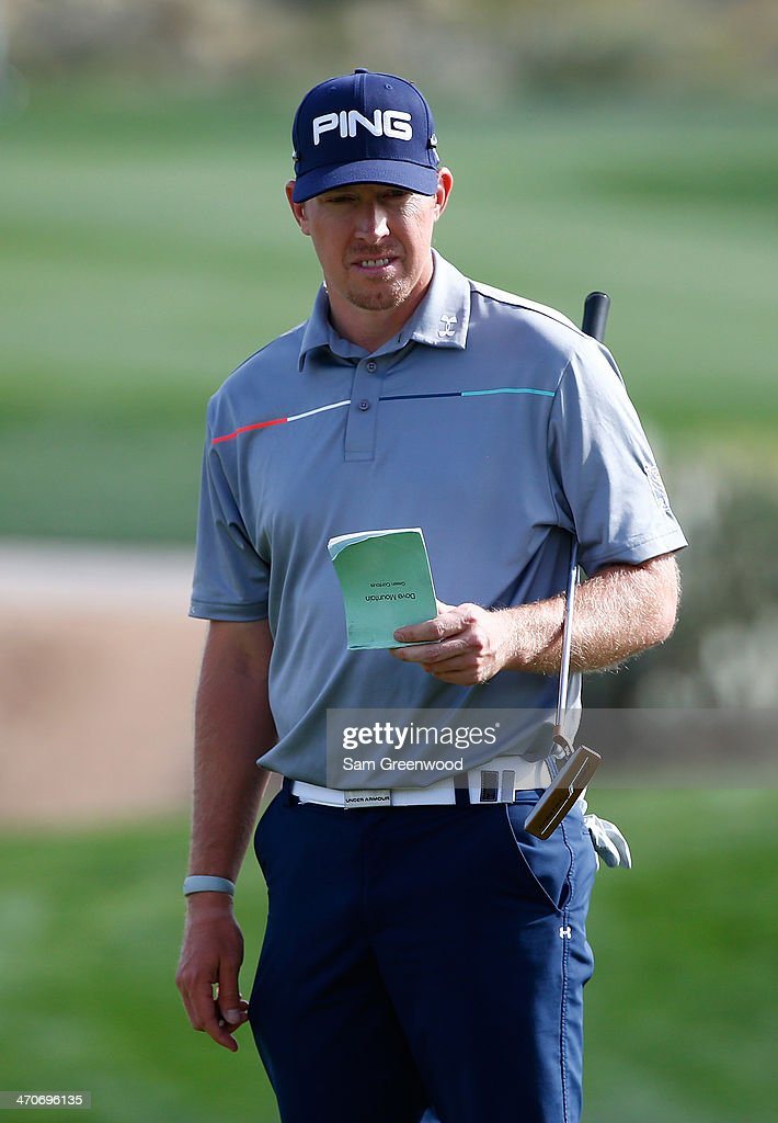 Hunter Mahan looks on during the first round of the World Golf Championships - Accenture Match Play Championship at The Golf Club at Dove Mountain on February 19, 2014 in Marana, Arizona.
