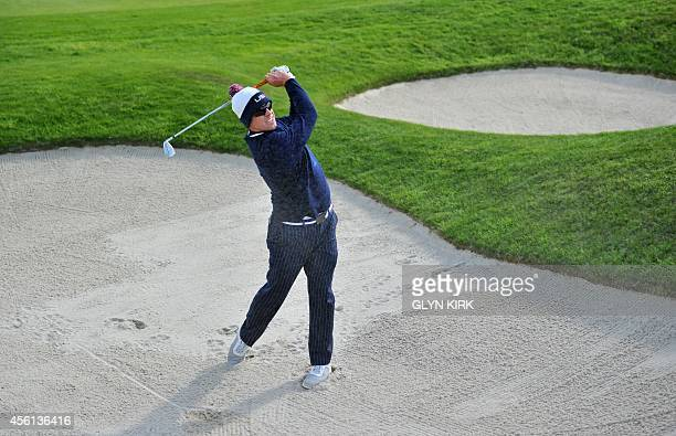Hunter Mahan of Team US plays out of the bunker on the third hole during the foursome afternoon match on the first day of the Ryder Cup golf...