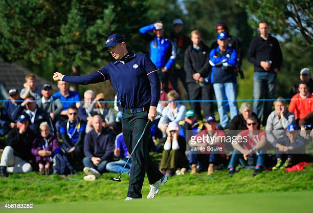 Hunter Mahan of the United States celebrates a putt on the 14th hole during the Morning Fourballs of the 2014 Ryder Cup on the PGA Centenary course...