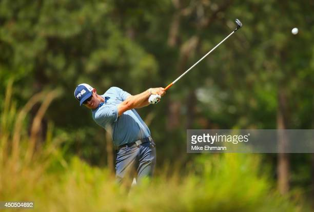 Hunter Mahan of the United States hits a tee shot on the seventh hole during the first round of the 114th US Open at Pinehurst Resort Country Club...