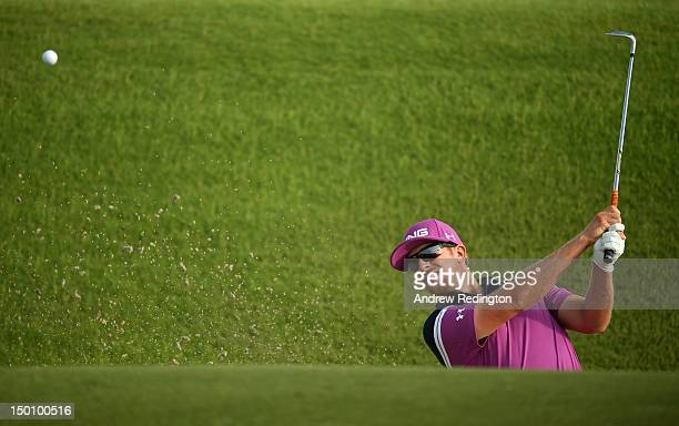 Hunter Mahan of the United States hits out of the sand on the tenth hole during Round Two of the 94th PGA Championship at the Ocean Course on August...
