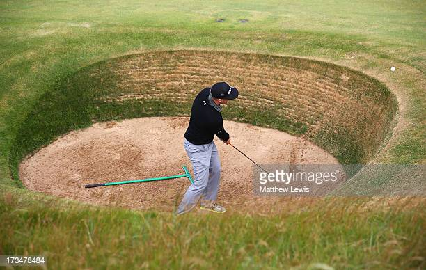 Hunter Mahan of the United States hits the ball out of a bunker ahead of the 142nd Open Championship at Muirfield on July 15 2013 in Gullane Scotland