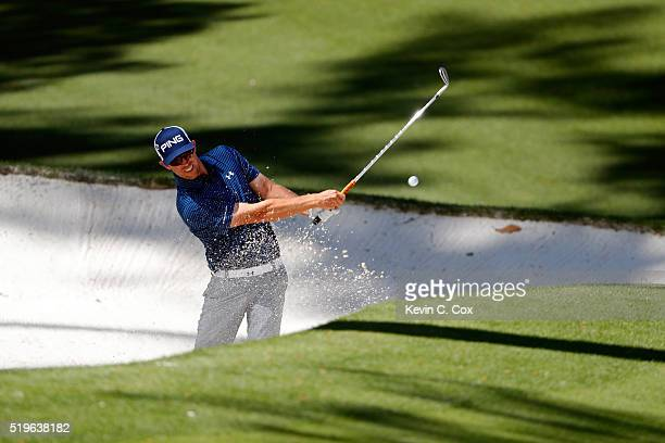 Hunter Mahan of the United States plays a shot from a bunker on the tenth hole during the first round of the 2016 Masters Tournament at Augusta...