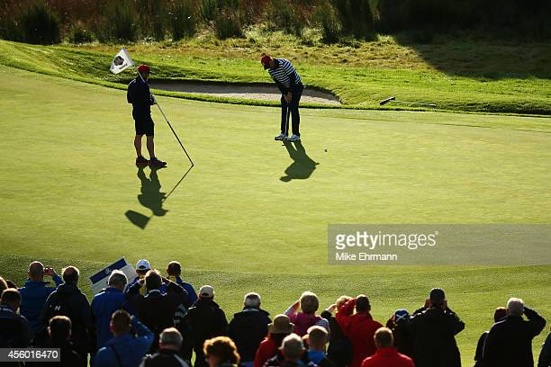 Hunter Mahan of the United States putts on the 10th green during practice ahead of the 2014 Ryder Cup on the PGA Centenary course at the Gleneagles...