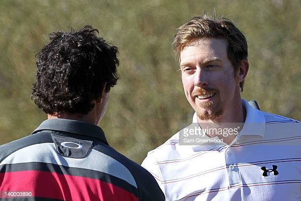 Hunter Mahan of the United States shakes hands with Rory McIlroy of Northern Ireland after winning the championship match 2 and 1 on the 17th hole...