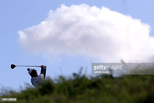 Hunter Mahan of the United States tees off on the 12th hole during the Afternoon Foursomes of the 2014 Ryder Cup on the PGA Centenary course at the...