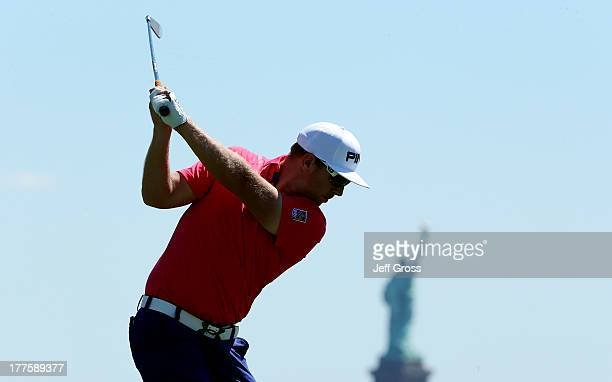 Hunter Mahan of the United States tees off on the second hole during the third round of The Barclays at Liberty National Golf Club on August 24 2013...
