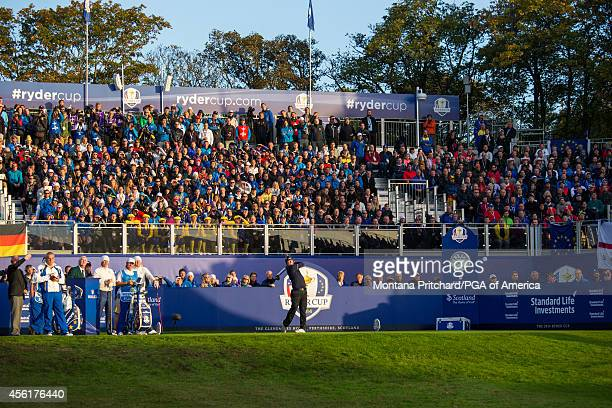 Hunter Mahan of the United States watches his tee shot on the first tee during the fourball matches for the 40th Ryder Cup at Gleneagles on September...