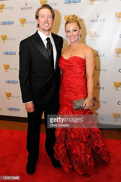 Hunter Mahan of the US Team and his wife Kandi Mahan arrive on the red carpet at the Gala Celebration for the 2011 Presidents Cup at the Crown Towers...