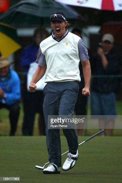 Hunter Mahan of the US Team celebrates making a putt to win the match during the Day Three Afternoon FourBall Matches of the 2011 Presidents Cup at...