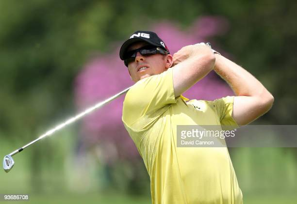 Hunter Mahan of the USA plays his second shot at the 9th hole during the first round of the Nedbank Golf Challenge at the Gary Player Country Club at...
