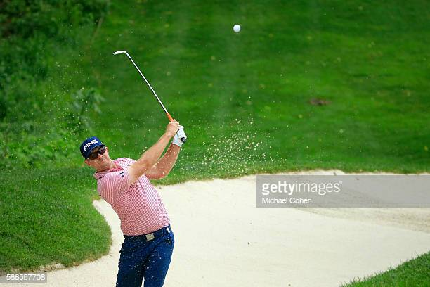 Hunter Mahan plays a shot from a bunker on the ninth hole during the first round of the John Deere Classic at TPC Deere Run on August 11 2016 in...