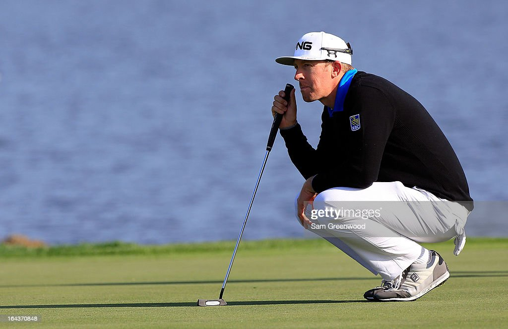 Hunter Mahan plays a shot on the 6th hole during the second round of the Arnold Palmer Invitational presented by MasterCard at the Bay Hill Club and Lodge on March 22, 2013 in Orlando, Florida.