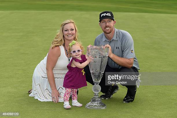 Hunter Mahan poses with his wife Kandi daughter Zoe and the tournament trophy after winn ing The Barclays at Ridgewood Country Club on August 24 2014...