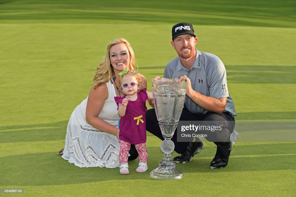 Hunter Mahan poses with his wife Kandi, daughter Zoe and the tournament trophy after winn ing The Barclays at Ridgewood Country Club on August 24, 2014 in Paramus, New Jersey.