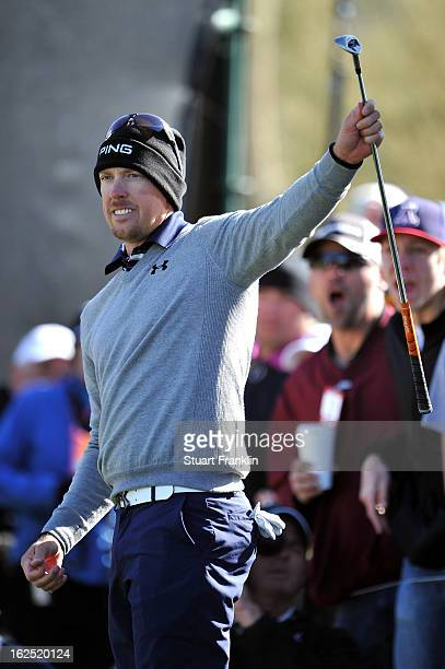 Hunter Mahan reacts after he chipped in for a birdie to win the hole on the 12th hole during the semifinal round of the World Golf Championships...
