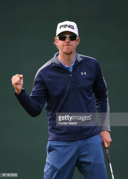 Hunter Mahan reacts after making his birdie putt on the 16th hole during the final round of the Waste Management Phoenix Open at TPC Scottsdale on...