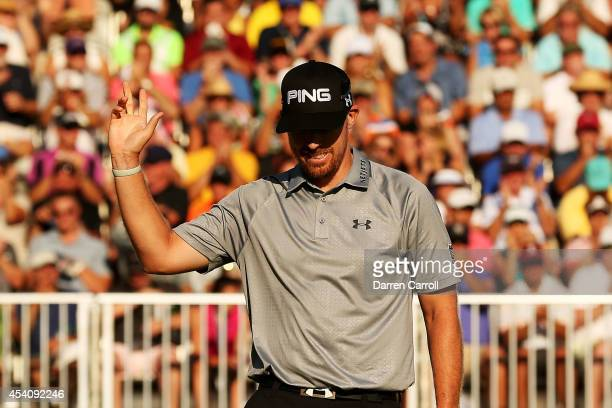 Hunter Mahan reacts as he finishes on the 18th green during the final round of The Barclays at The Ridgewood Country Club on August 24 2014 in...