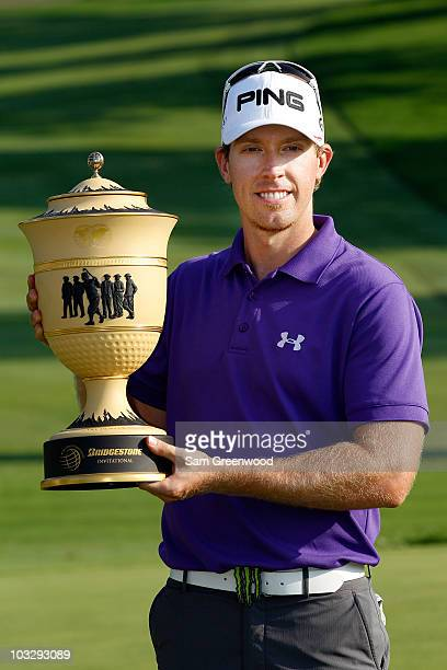 Hunter Mahan smilles while holding the Gary Player Cup after winning the World Golf Championships Bridgestone Invitational on the South Course at...