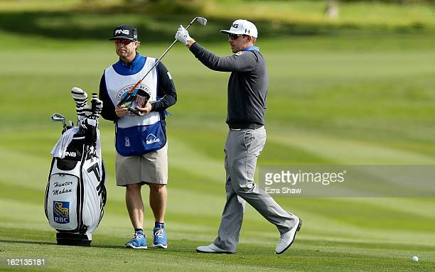 Hunter Mahan waits with his caddie John Wood during the first round of the ATT Pebble Beach National ProAm at Pebble Beach Golf Links on February 7...