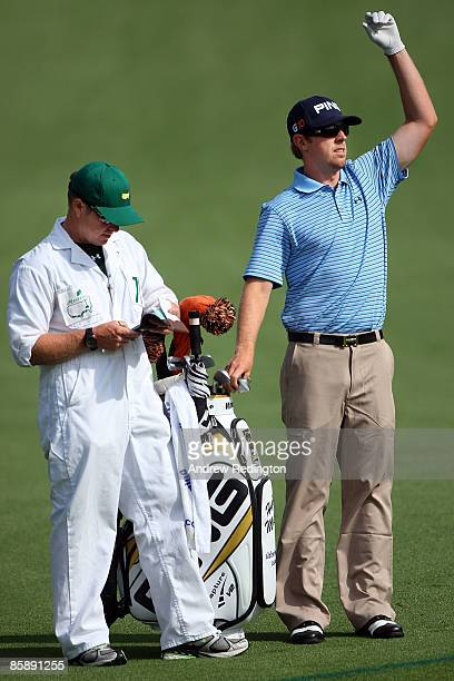 Hunter Mahan waits with his caddie John Wood on the second hole during the second round of the 2009 Masters Tournament at Augusta National Golf Club...