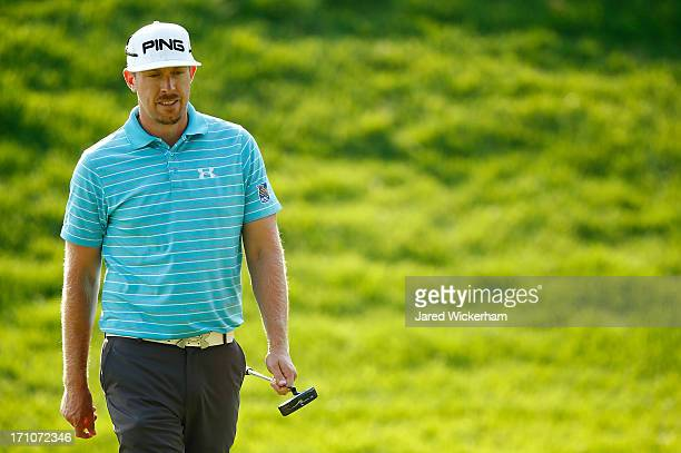 Hunter Mahan walks the green on the 18th hole during the second round of the 2013 Travelers Championship at TPC River Highlands on June 21 2012 in...
