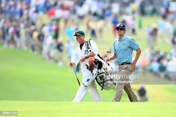 Hunter Mahan walks with his caddie John Wood in the first fairway during the second round of the 2009 Masters Tournament at Augusta National Golf...
