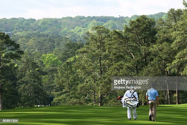 Hunter Mahan walks with his caddie John Wood on the second hole during the second round of the 2009 Masters Tournament at Augusta National Golf Club...