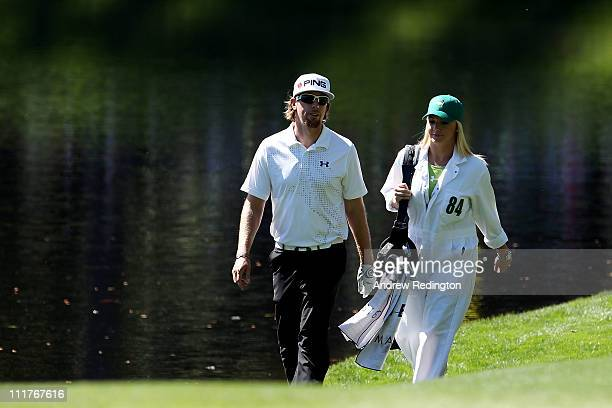 Hunter Mahan walks with his wife Kandi during the Par 3 Contest prior to the 2011 Masters Tournament at Augusta National Golf Club on April 6 2011 in...