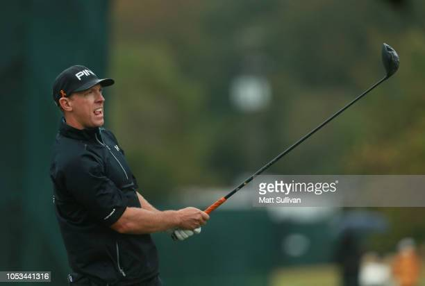 Hunter Mahan watches his tee shot on the sixth hole during the first round of the Sanderson Farms Championship at the Country Club of Jackson on...