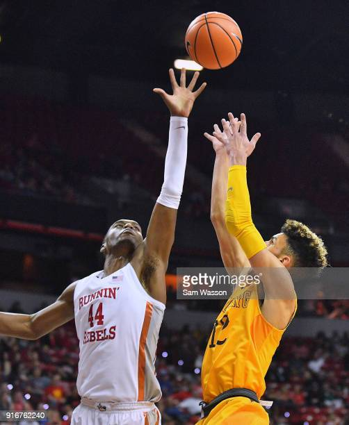 Hunter Maldonado of the Wyoming Cowboys shoots against Brandon McCoy of the UNLV Rebels during their game at the Thomas Mack Center on February 10...