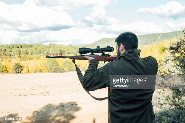 hunter man on the mountain with rifle - 狙撃兵 ストックフォトと画像