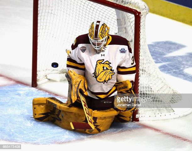 Hunter Miska of the MinnesotaDuluth Bulldogs makes a save against the Harvard Crimson during game one of the 2017 NCAA Division I Men's Hockey...