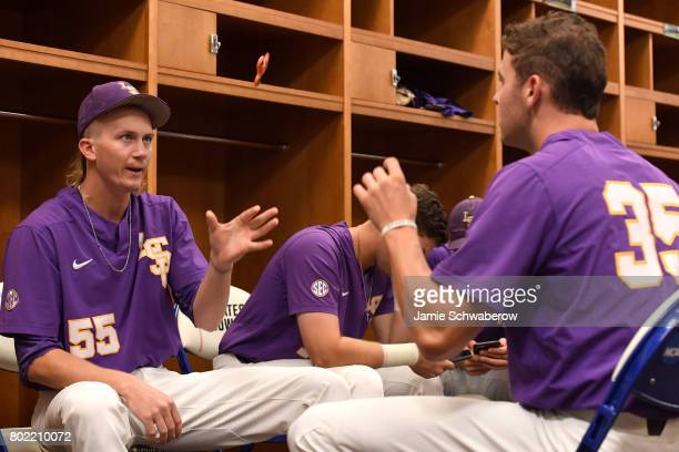 Hunter Newman and Alex Lange of Louisiana State University flip a toy to each other in the locker room before they take on the University of Florida...