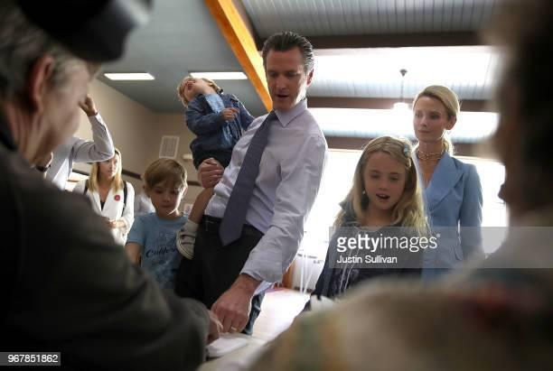 Hunter Newsom Dutch Newsom democratic California gubernatorial candidate Lt Gov Gavin Newsom Montan Newom and Jennifer Siebel Newsom sign in to vote...