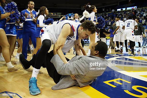 J Hunter of the Georgia State Panthers celebrates with his father head coach Ron Hunter of the Georgia State Panthers after defeating the Georgia...