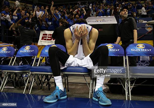 J Hunter of the Georgia State Panthers is overcome with joy after his team defeated the Georgia Southern Eagles during the Sun Belt Conference Men's...