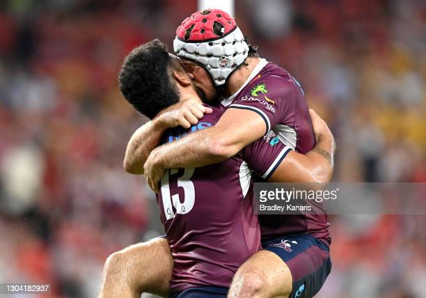Hunter Paisami is kissed by Fraser McReight of the Reds as they celebrate victory after the round two Super Rugby AU match between the Melbourne...