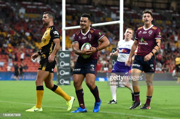 Hunter Paisami of the Reds celebrates scoring a try during the round five Super RugbyAU match between the Queensland Reds and the Western Force at...