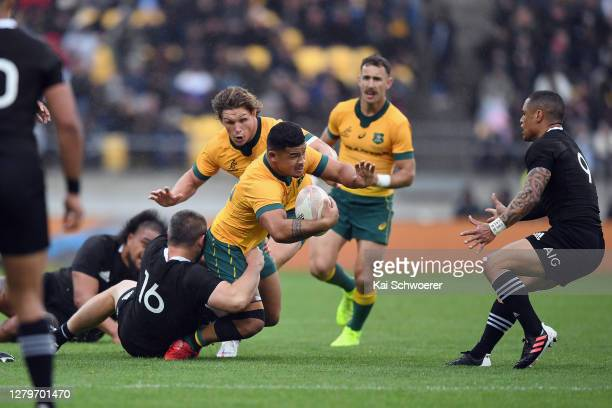 Hunter Paisami of the Wallabies is tackled by Dane Coles of the All Blacks during the Bledisloe Cup match between the New Zealand All Blacks and the...