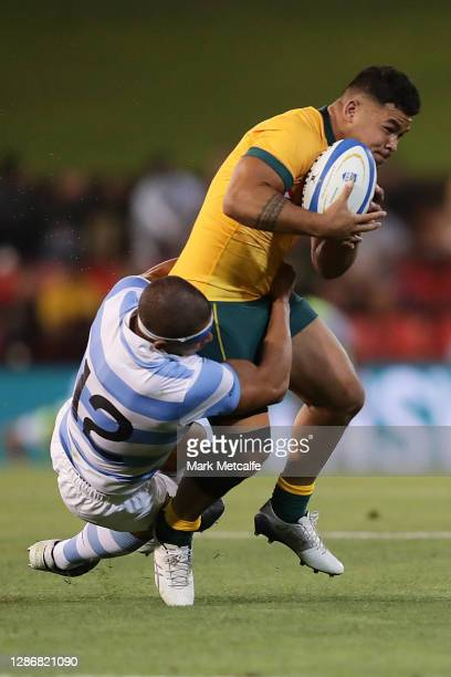 Hunter Paisami of the Wallabies Is tackled by Santiago Chocobares of the Pumas during the 2020 Tri-Nations match between the Australian Wallabies and...