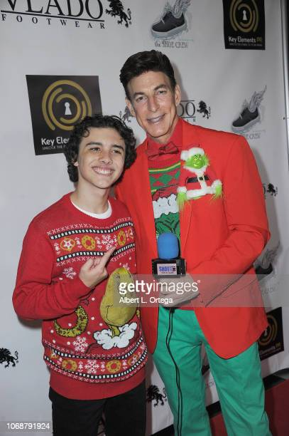 Hunter Payton and BJ Curos arrive for Hunter Payton And The Shoe Crew Holiday Charity Fundraiser Screening of Illumination's 'The Grinch' Benefiting...